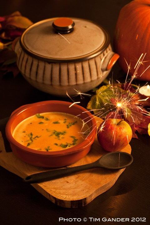 Pumpkin soup in a bowl on a place setting