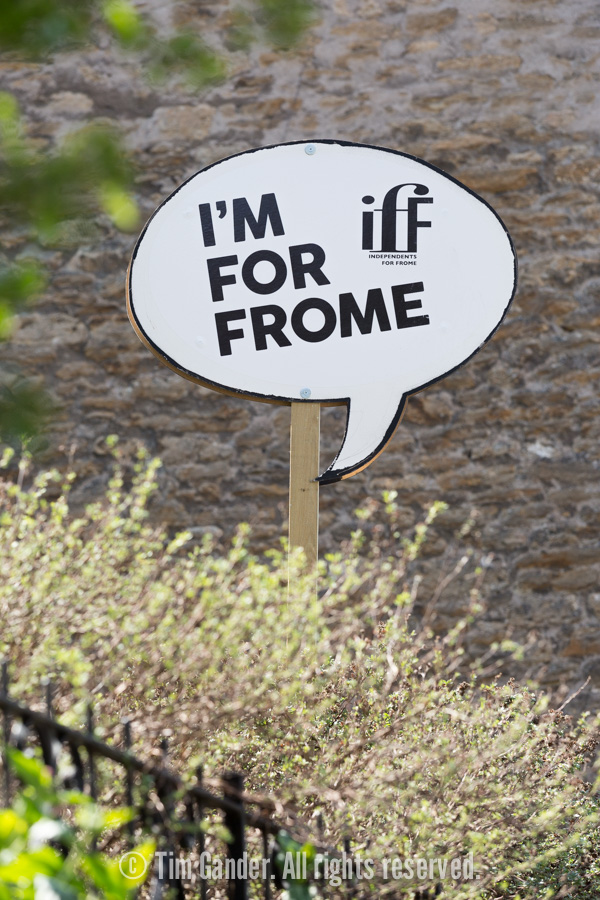 An Independents for Frome board in the shape of a speech bubble is erected on a wooden baton in a resident's garden.