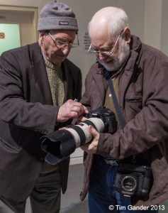 Brian Sawyer and Bill Collett try out a camera and lens