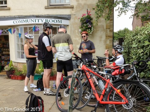 Cyclists at a village shop taking a refreshment break