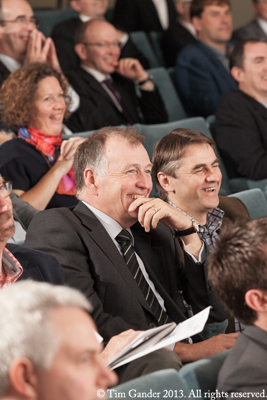 Business people laughing in a lecture theatre setting