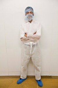Tim Gander in full protective suit for hygiene purposes during a visit to Westbury Dairy