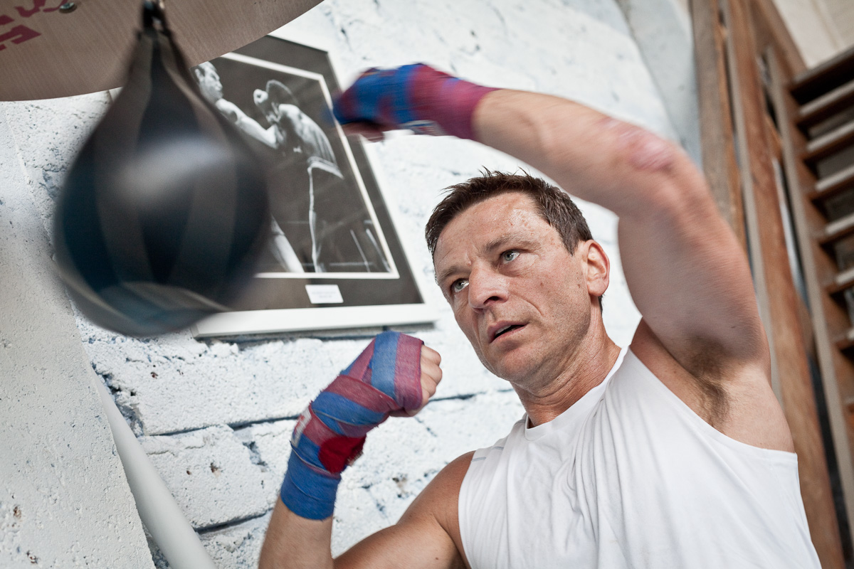 Allan Meek works out on a punch bag at a gym in Wales.