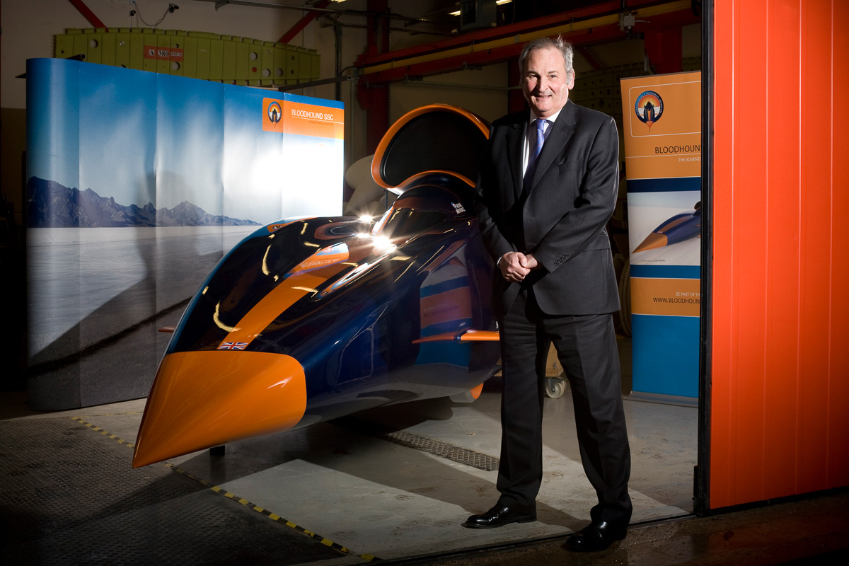 Richard Noble of the Bloodhound Super Sonic Car project poses with a model of Bloodhound SSC at a workshop in Bristol.