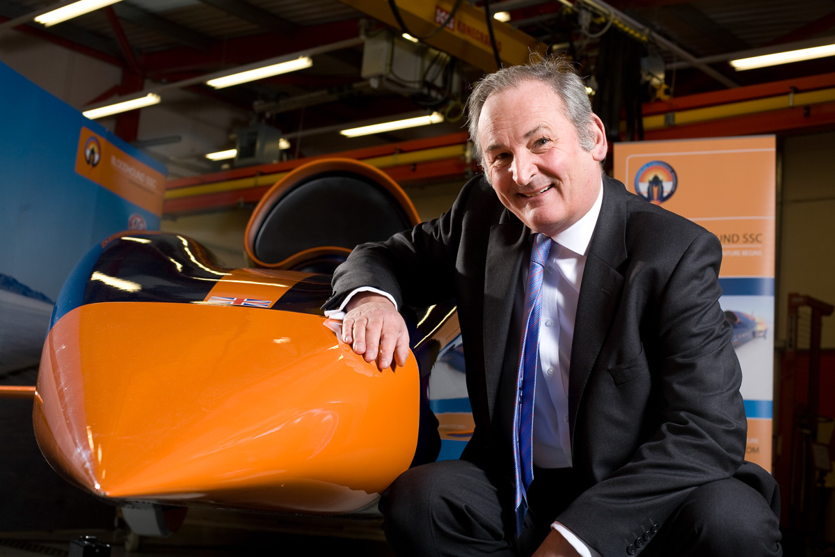 Richard Noble of the Bloodhound Super Sonic Car project poses with a model of Bloodhound at a workshop in Bristol.