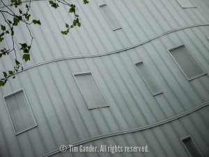 Architectural detail of a grey building in London with wavy walls
