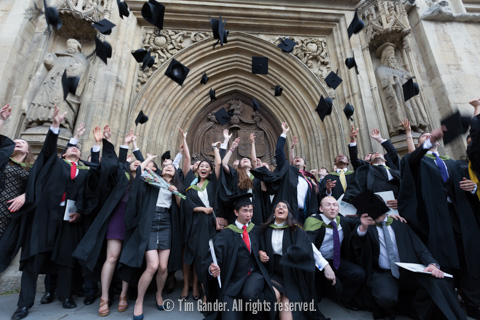 University of Bath graduates throw their hats in the air in celebration