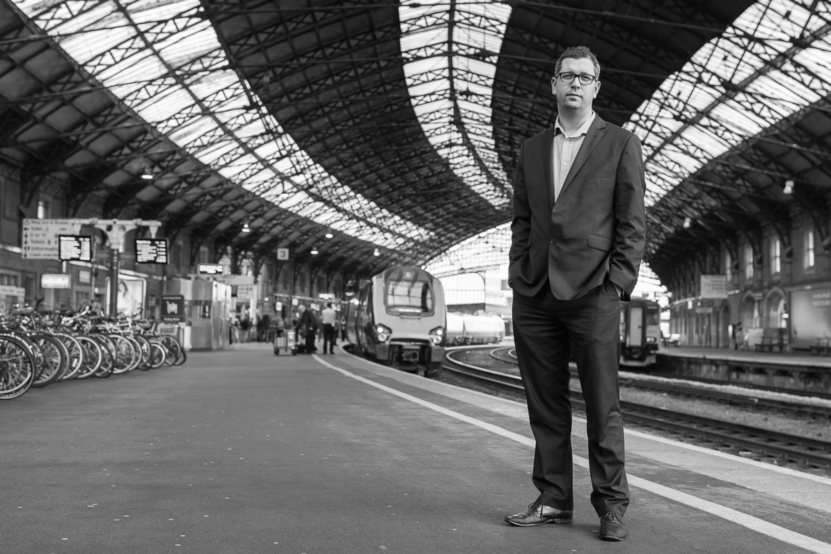 Head of communications at First Great Western, Dan Panes stands on a platform at Bristol Temple Meads station.