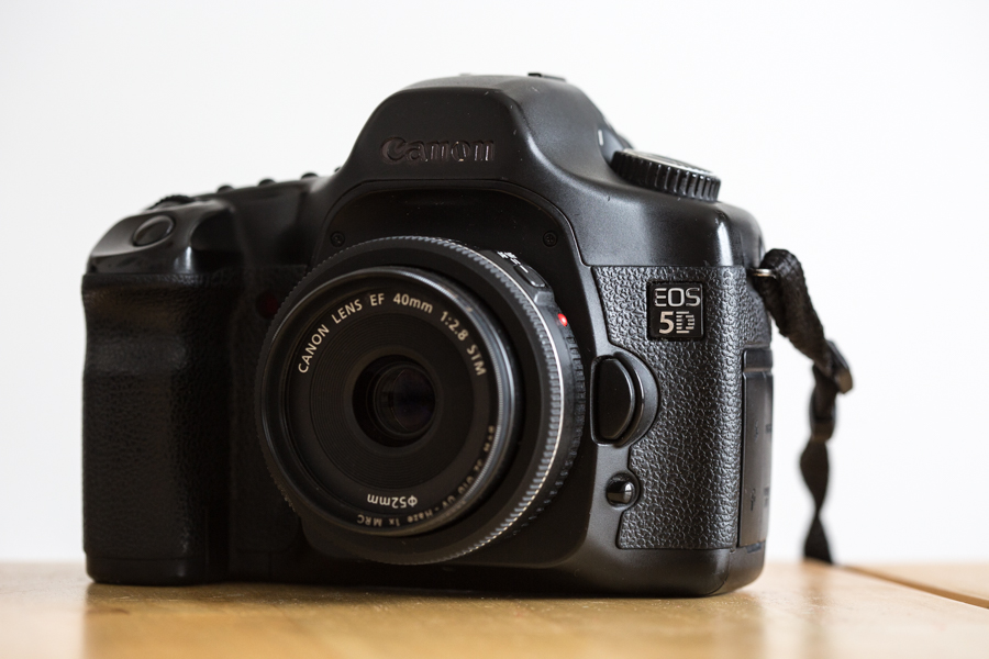 Canon 5D original or MKI camera body with a 40mm f/2.8 pancake lens attached.