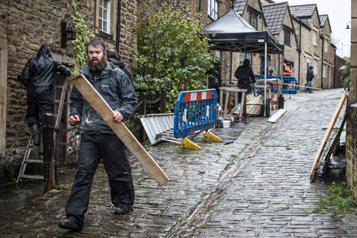 Carpenters and set builders at work in Frome's Gentle Street for the filming of Poldark.