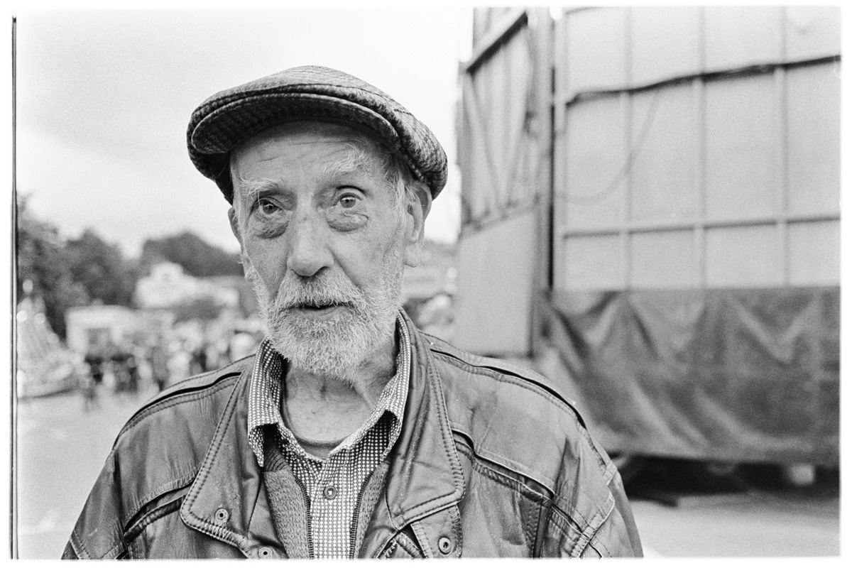Geoff, aged 64, portrait taken in the old cattle market in Frome, Somerset with the funfair in the background.