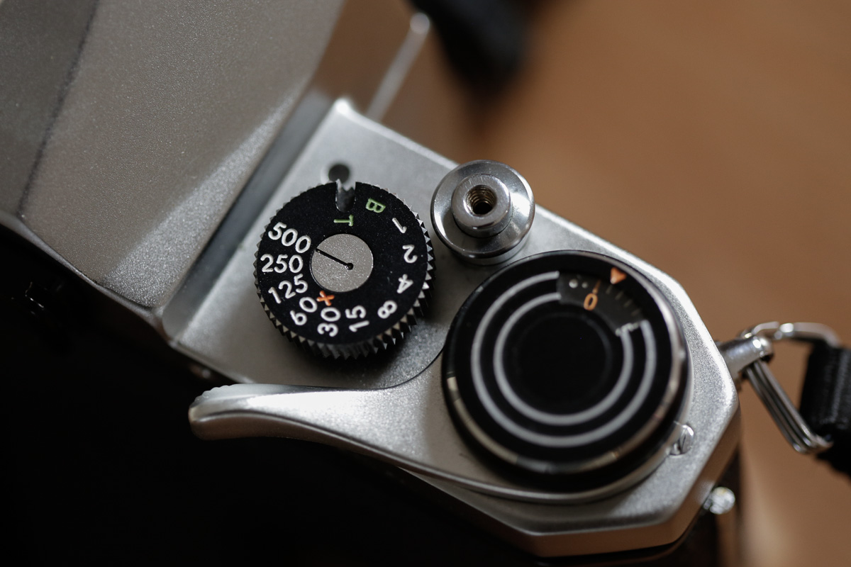 Detail showing the film advance lever, shutter speed dial and shutter release button.
