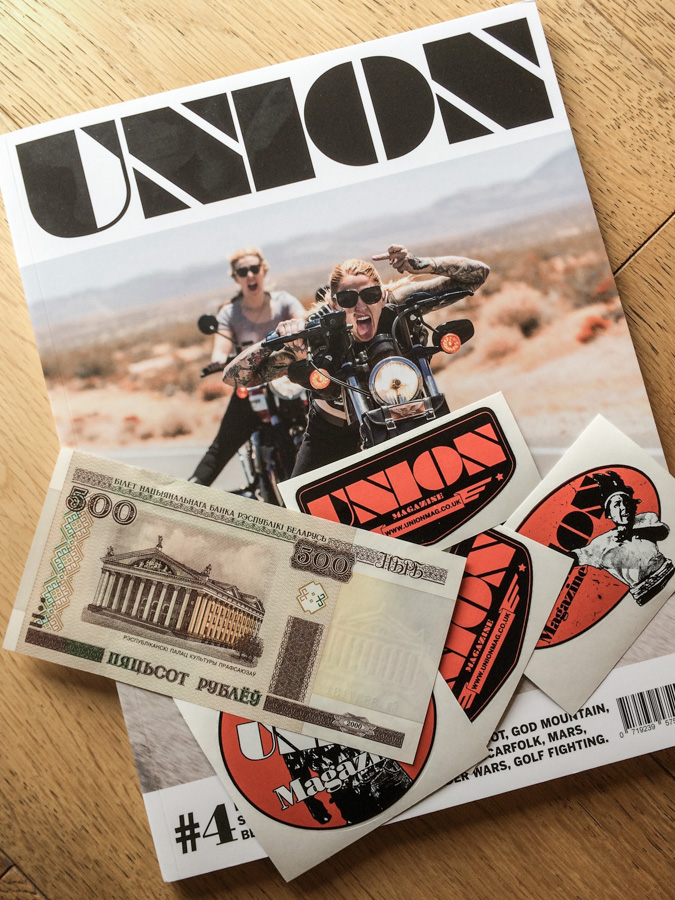 Union magazine cover with Union stickers and a cash bill arranged on top.