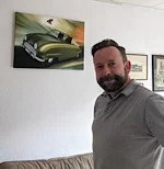 Happy customer with a Saab 92 on the wall