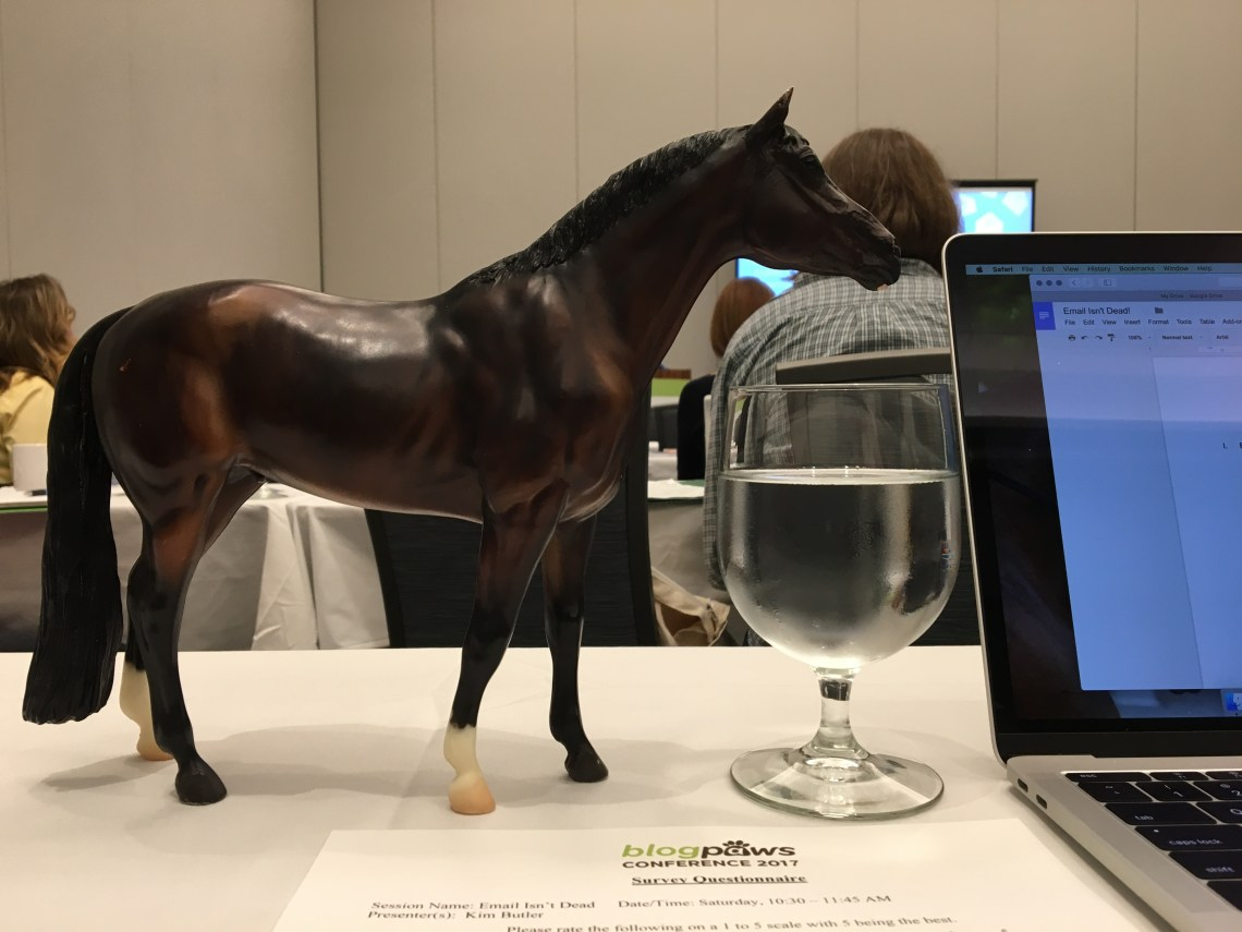 Breyer horse takes notes at BlogPaws 2017