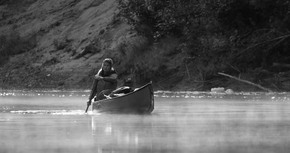 Heidi Braun canoeing in morning mist on the Coulonge River, Quebec
