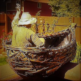 "Roger Williams, In a Skiff | 2014 | bronze and wicker | 18"" x 18"" x 9"""