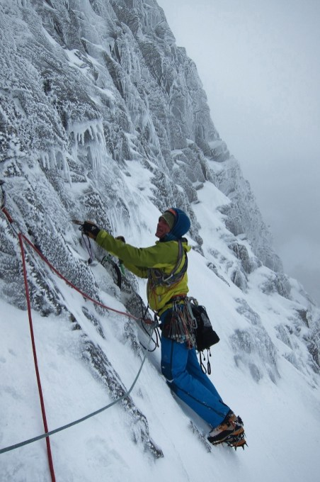 Heading out onto final pitch to the girdle ledge...
