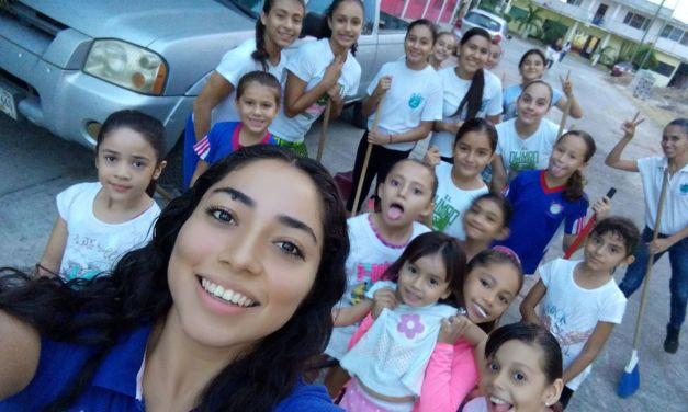 Niñas gimnastas se unen a limpieza de la ciudad