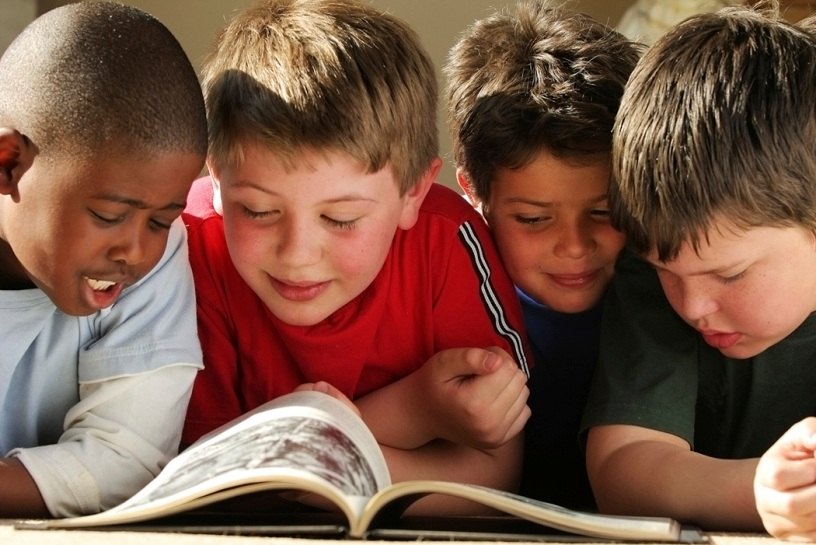 Boys reading books - education improvement