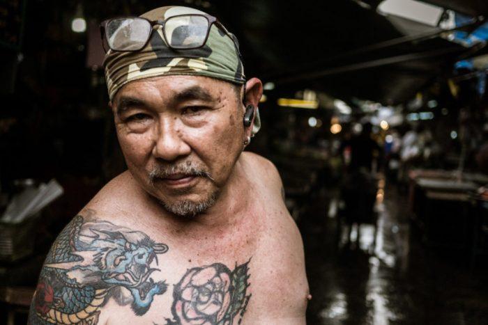 Fishmonger at Khlong Thoey Market, Bangkok