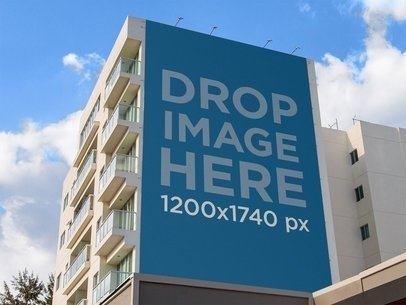placeit billboard mockup on the side of an apartment building