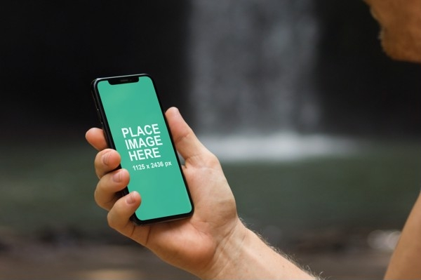 man looking at iphone x from do you mockup