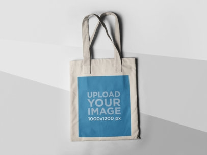 placeit tote bag mockup lying on a three colors surface