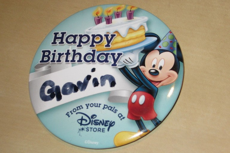 free disney birthday button at disneyland and disney stores