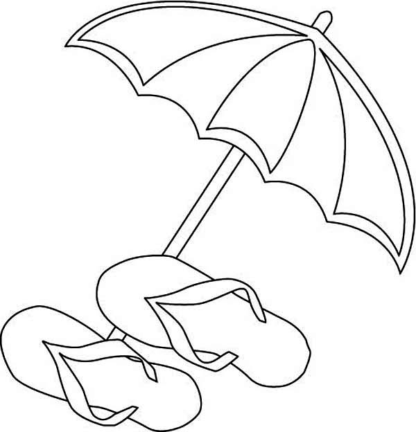 a beach umbrella and slippers and flip flops