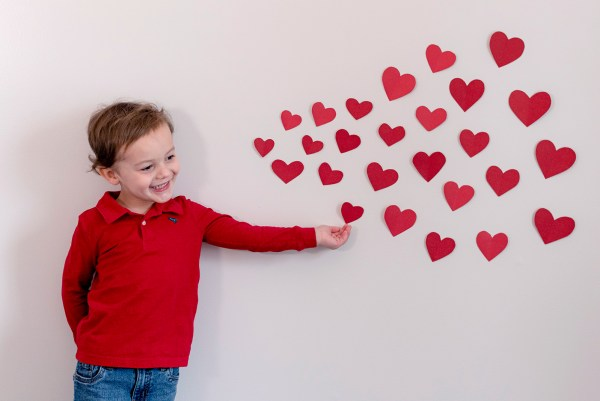 valentine's day blowing paper heart kisses diy rva family photographer