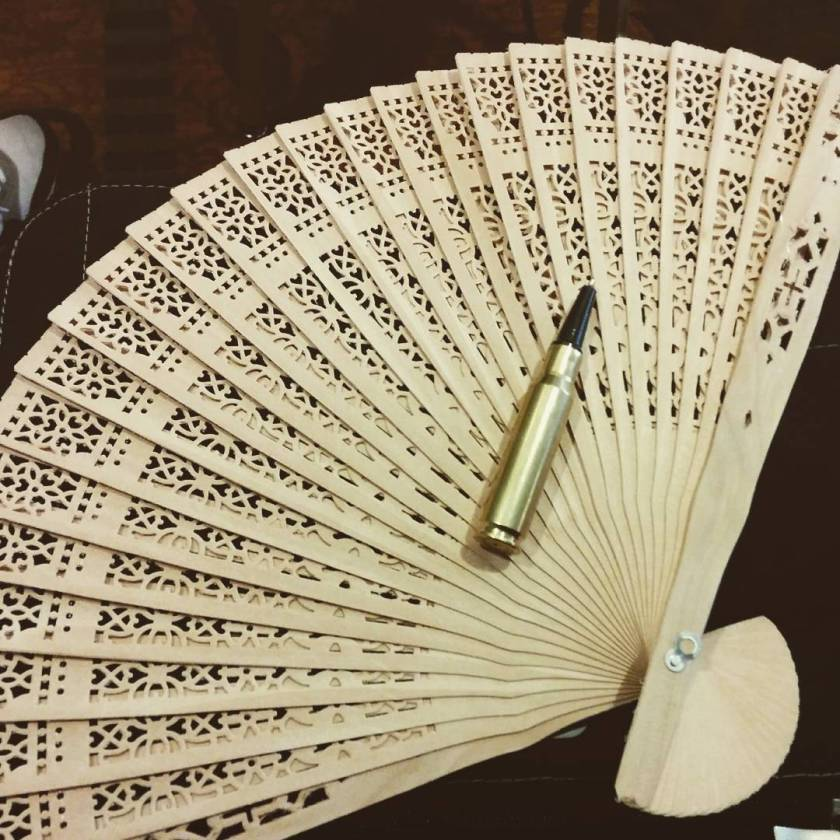 bullet pen and wooden fan
