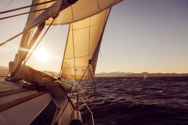 Sailing a yacht in the sunset