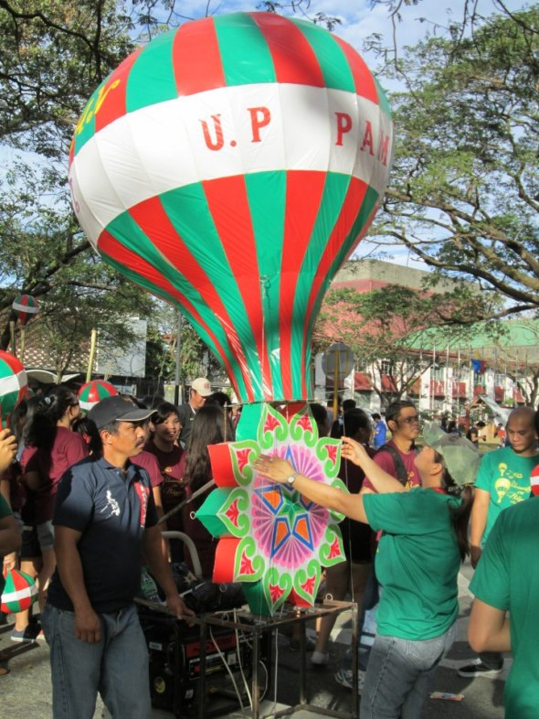 Students of UP Pampanga showcase their hot air balloon lantern at the 2012 Lantern Parade in UP Diliman