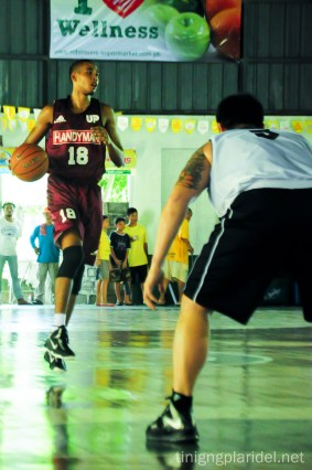 Center Matthew Ball warms up in an exhibition game of the UP Men's Basketball Team against Global Port Batang Pier last June 15. Photo by Anjon Galauran