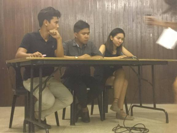 STAND UP CMC fielded (from left) Mikko Ringia, Dave Guino, and Hazel Lobres to discuss student safety and org autonomy. Photo by Anton Onato.