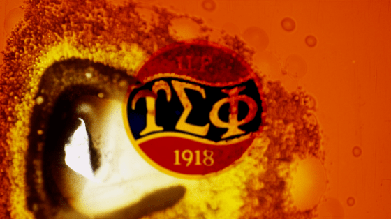 Upsilon Sigma Phi logo burned in a celluloid-like effect