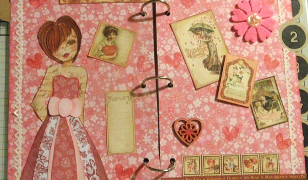 Mixed media journal page featuring a paper doll