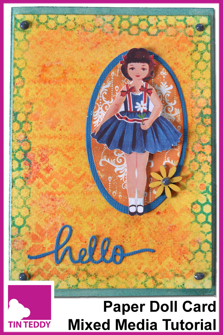 An illustrated tutorial to make a paper doll card featuring a Tin Teddy paper doll, Brusho powders, stencilling and quite a lot of Distress Ink!  April entry for the Mixed Media Monthly Challenge Blog.