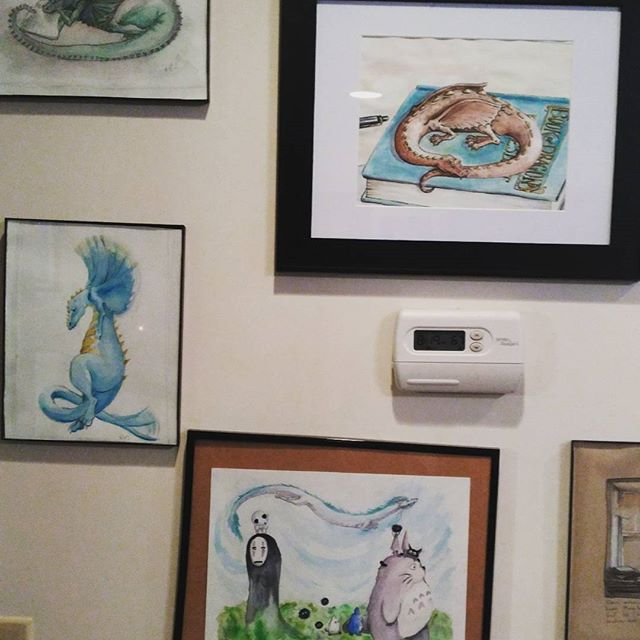 Busy cooking and cleaning today so you get more of my #paintings  framed and hung. And our thermostat. (Ghibli Spirits painting kept falling down and is still crooked). All of these pieces are currently available on my Etsy shop: https://www.etsy.com/shop/tinyBookDragonArt?ref=ss_profile #art #Watercolor #Dragon #dragonbook #dragonart #studioghibli #framing #spiritedaway #totoro #sootsprites #artist #illustration