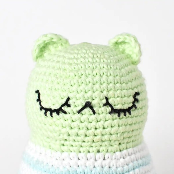 Face embroidery for your amigurumi dolls is a great way to give them lots of personality. The picture shows a finished amigurumi doll with the face embroidery completed.