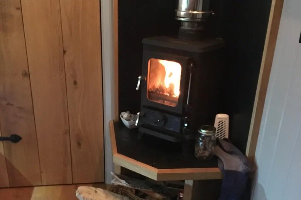 the hobbit cast iron stove at benllech shepherds hut