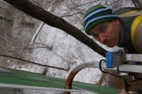 Karl on ladder installing windows