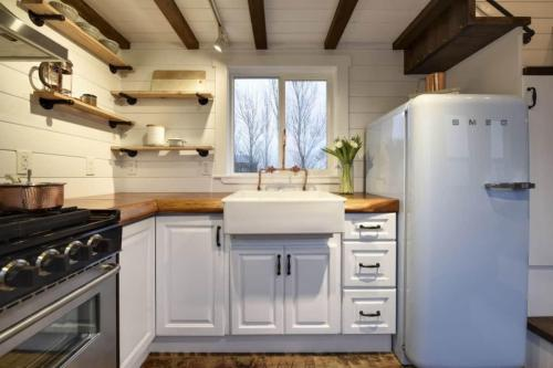 small resolution of what really makes this tiny kitchen stand out is the attention to detail and the fact that it s tucked beneath a loft truly a great use of space