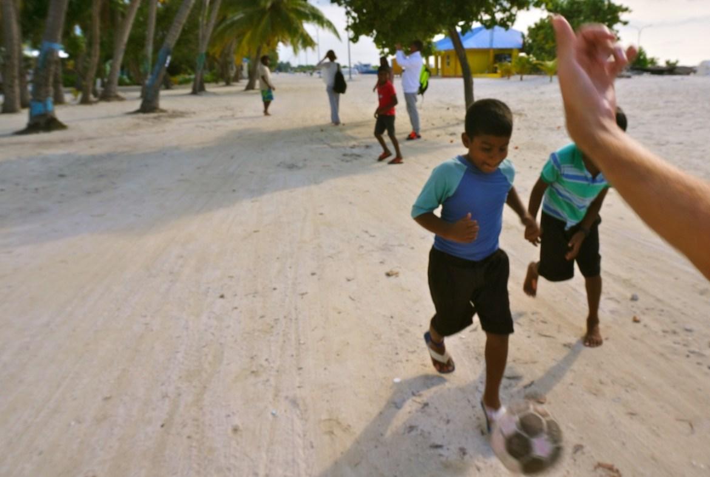 maldivian kids playing football
