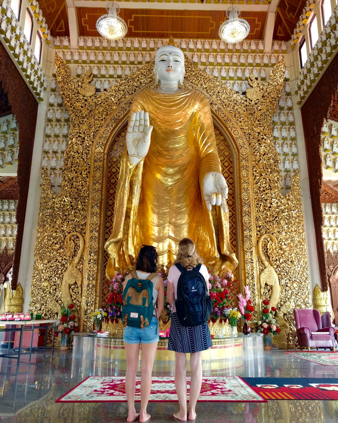 Admiring the golden Standing Buddha in Dharmikarama Burmese Temple, in Penang