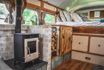 Wood textures and wood stove provide warm feel.