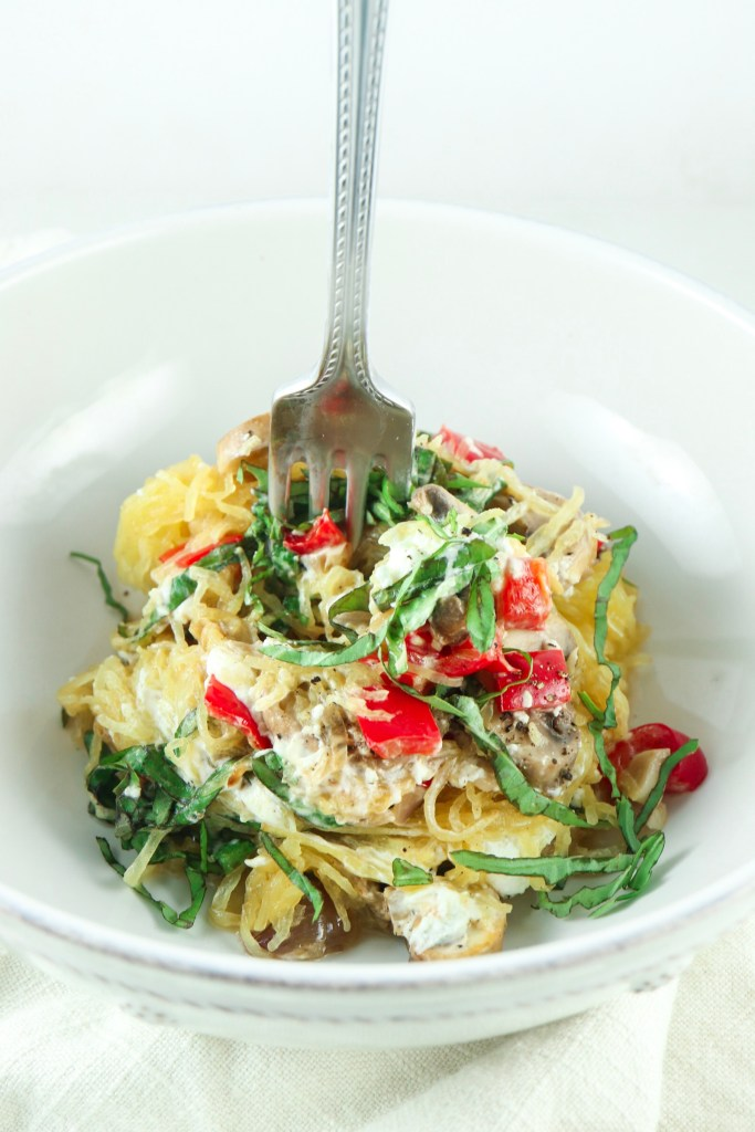 Mushroom and red pepper spaghetti squash with goat cheese and basil