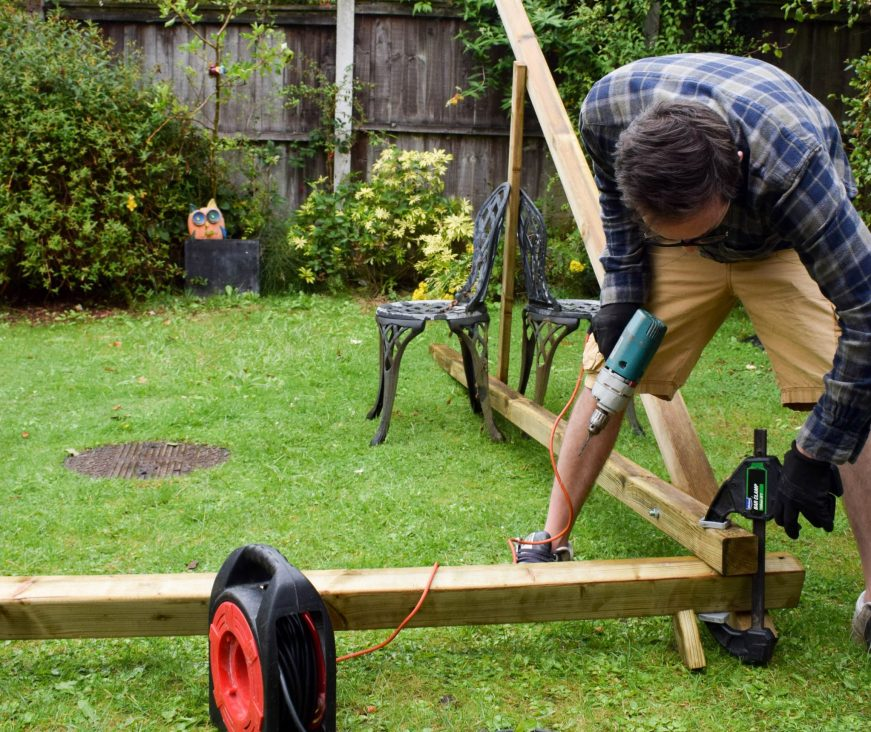 Garden Fun - new swing for the back garden - dad at work