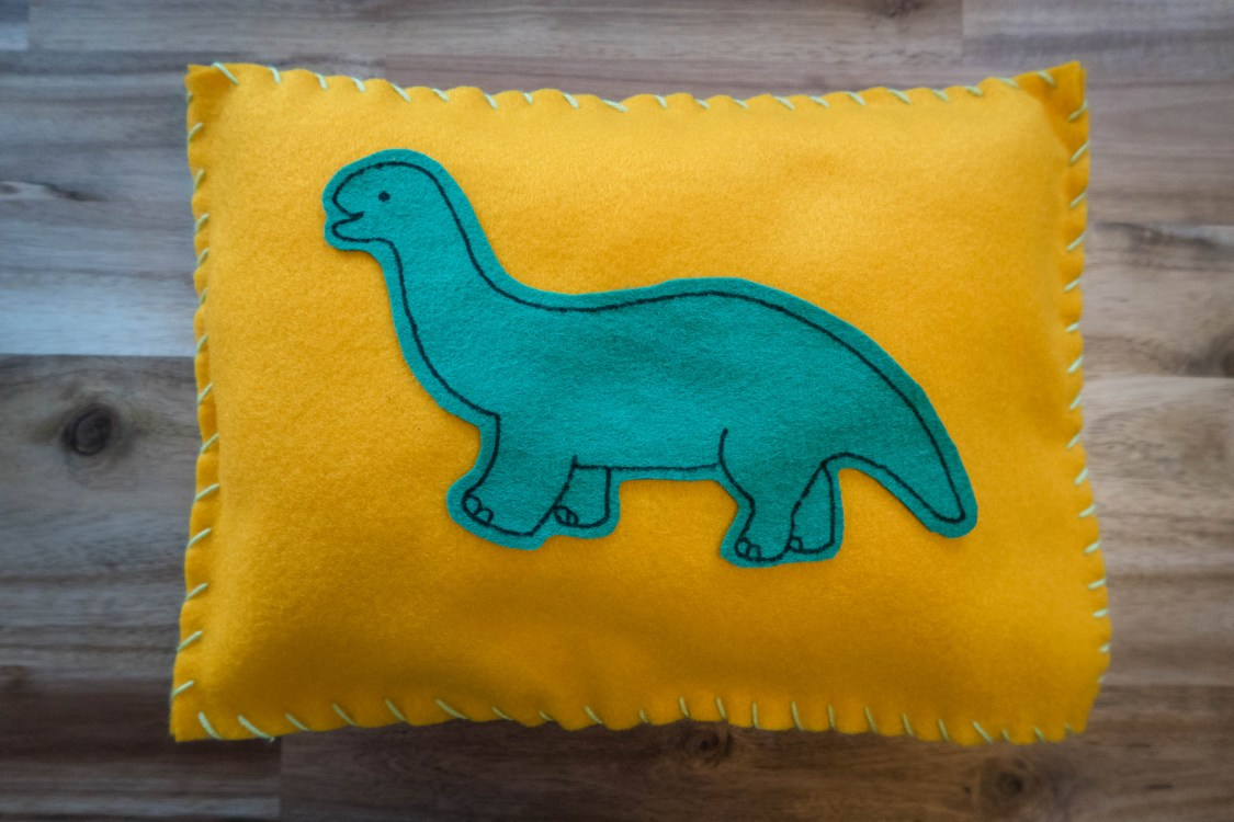 make your own dinosaur felt cushion - the finished result